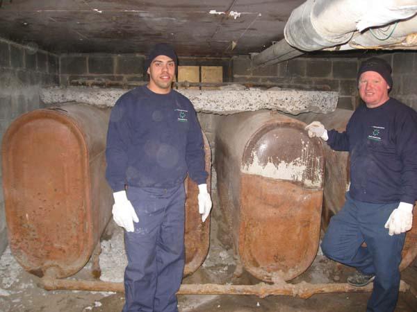 Photo of Ron and Justin prepare to remove four 250 gallon oil tanks