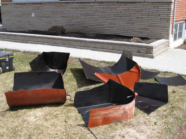 Photo of Crawlspace Oil Tank cut in 8 pieces to remove