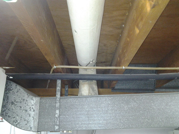 Photo of Forced Air Furnace Duct With Asbestos