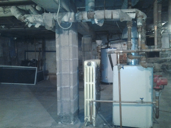 Photo of Residential Asbestos Pipe Insulation Removal (Before)