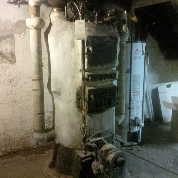 Photo of Old Boiler Covered with Asbestos Removal