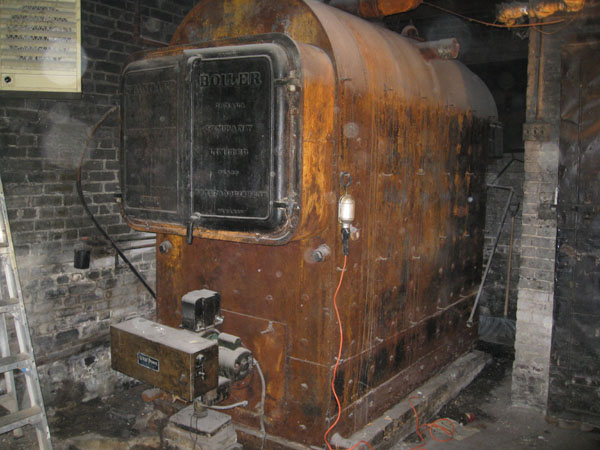 Photo of Preparing to remove a 1920s Solid Steel Commercial Boiler