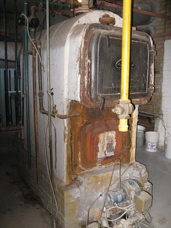 Photo of Preparing to remove Commercial Boiler with Asbestos