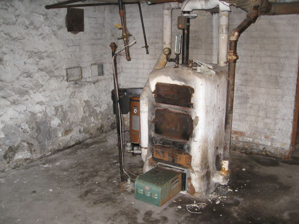 Photo of Boiler with Asbestos being Removed