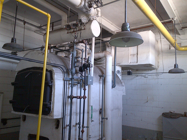 Photo of Industrial Boiler Room with Asbestos Pipes