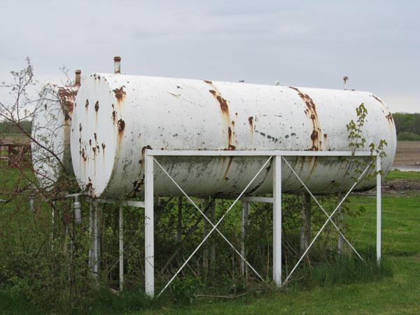 Photo of Two 1000 Gallon farm tanks on cradles