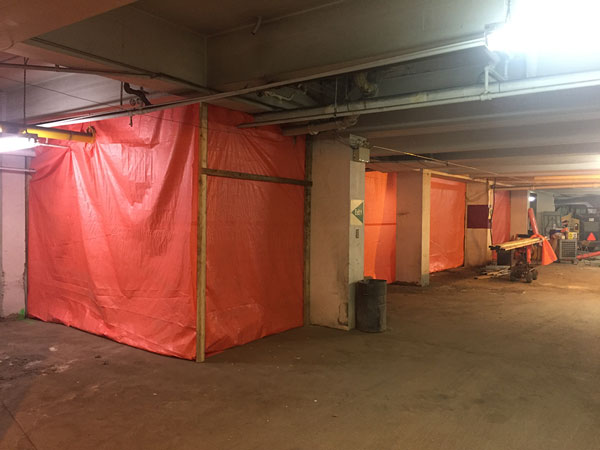 Photo of Commercial apartment building underground asbestos removal on piping