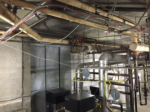 Photo of Asbestos wrapped heating pipes commercial building