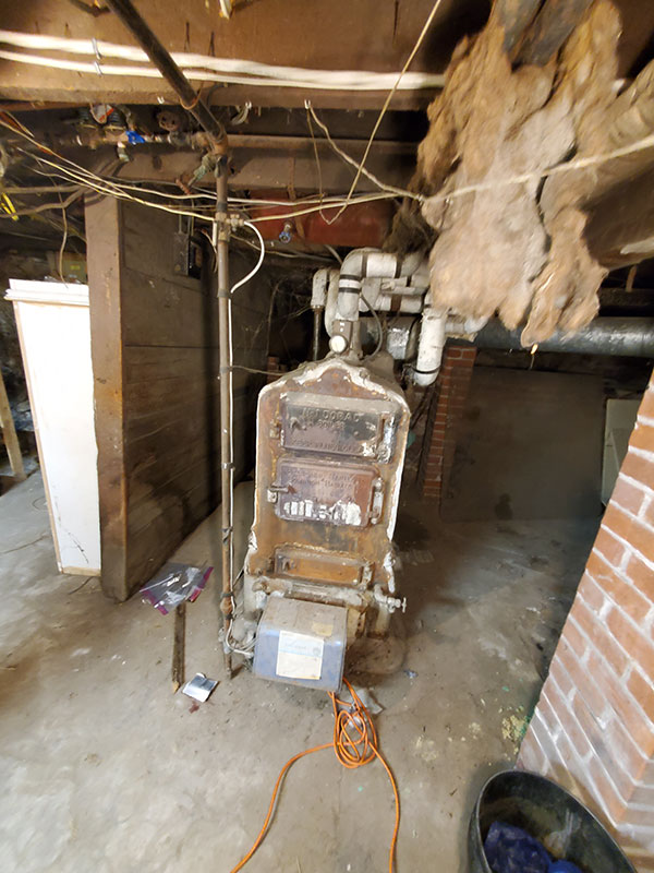 Photo of Residential boiler with asbestos