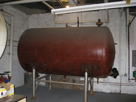 Photo of an Abandoned Water Storage 1500 Gallon Tank