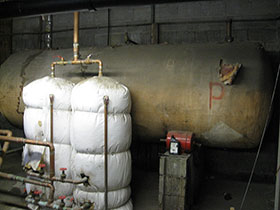 Photo of a Boiler covered with Asbestos