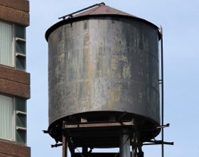 Photo of an old Cistern Tank on top of a building