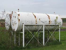 Photo of two 1000 Gallon tanks on cradles