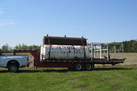 Photo of the ECO Metal Recycling Service Truck removing a Fuel Storage Tank in Tobermory, Ontario