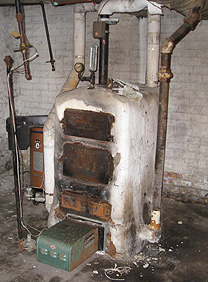Photo of an old boiler insulated with asbestos