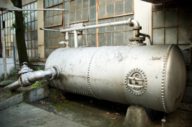 Photo of an Industrial Holding Tank in Forest