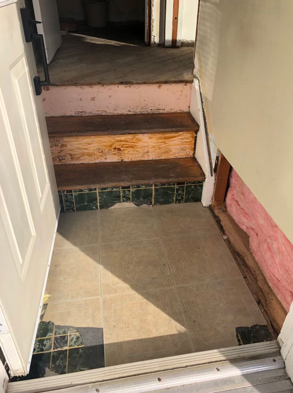 Photo of floor tiles insulated with asbestos in Oil Springs, Ontario