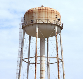 Photo of an rusty old water storage tank in Oil Springs