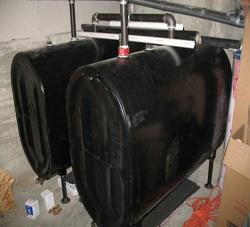 Photo of twin 100 gallon oil tanks