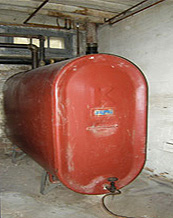 Photo of a furnace oil tank in basement of house