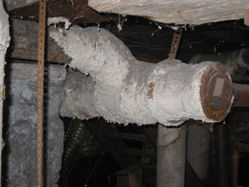 Photo of a Pipe covered with Asbestos, bad condition