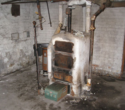Photo of an old residential boiler insulated with asbestos
