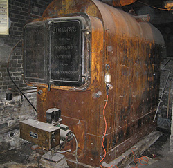 Photo of an old solid steel commercial boiler in Tobermory, Ontario