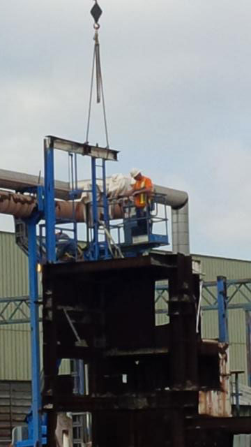 Photo of a Technician during the removal of HVAC equipment in Stone Mills