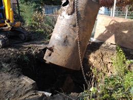 Photo of an excavator removing an Underground Storage Tank