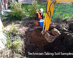 Photo of technician taking soil samples after removal of Underground Storage Tank in Brooke-Alvinston, Ontario