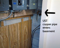 Photo of a Underground Storage Tank (UST) copper pipe entering basement