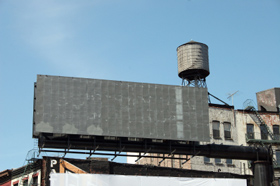 Photo of a Water Storage Tank on top of a building