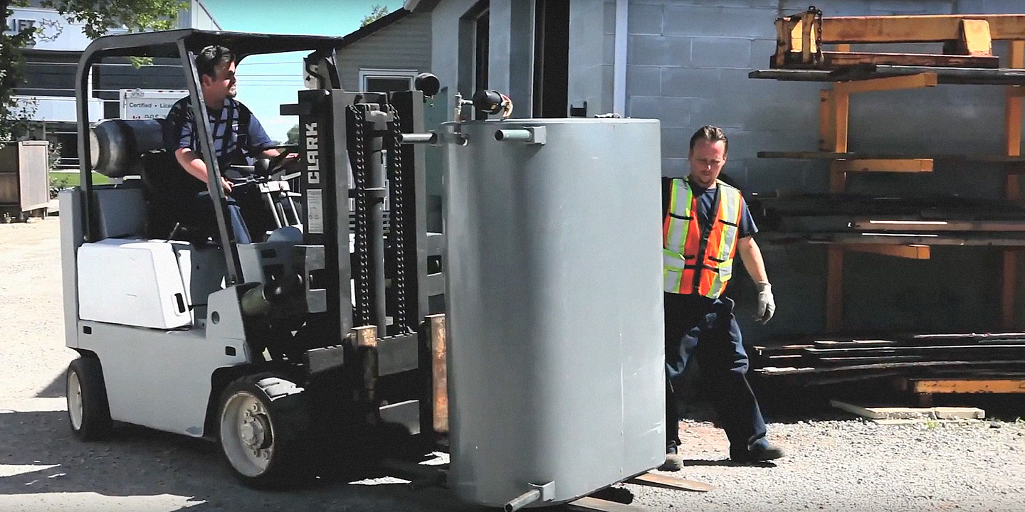Eco Metal crew removing an oil tank